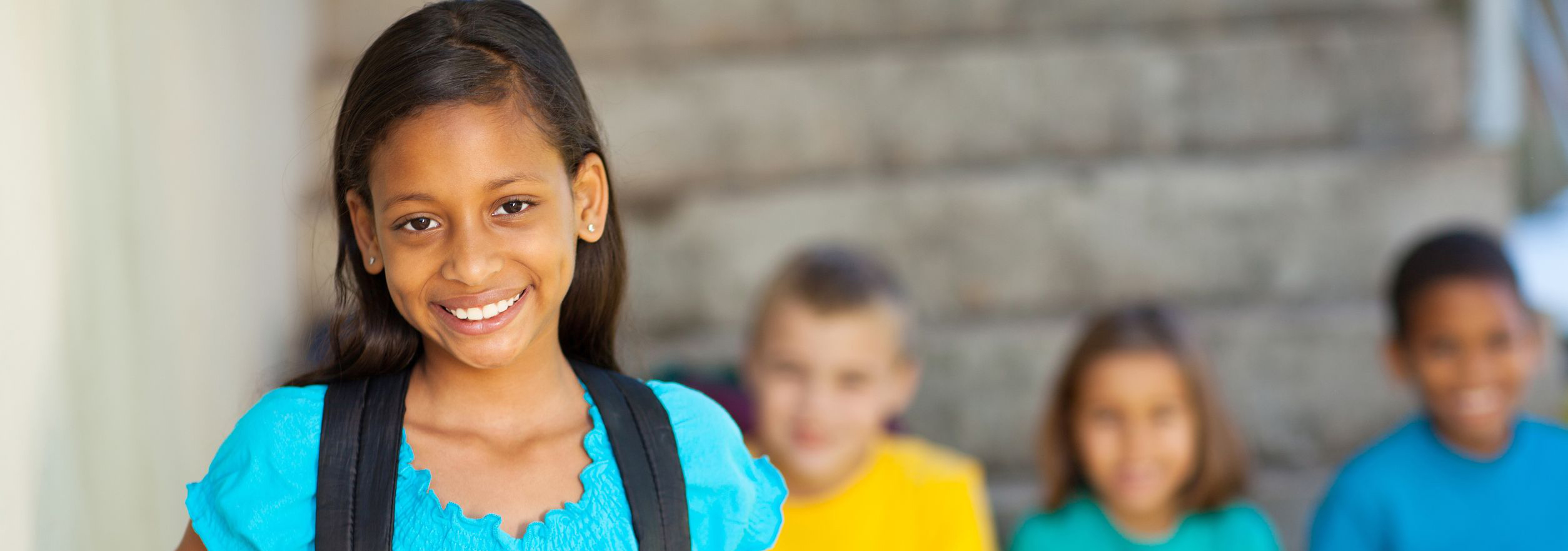 Young girl at school smiling